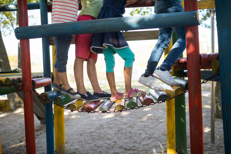Children walking on jungle gym at play ground stock photos