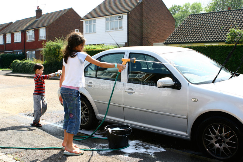 Spray Car Wash >> Children washing the car stock photo. Image of discipline ...