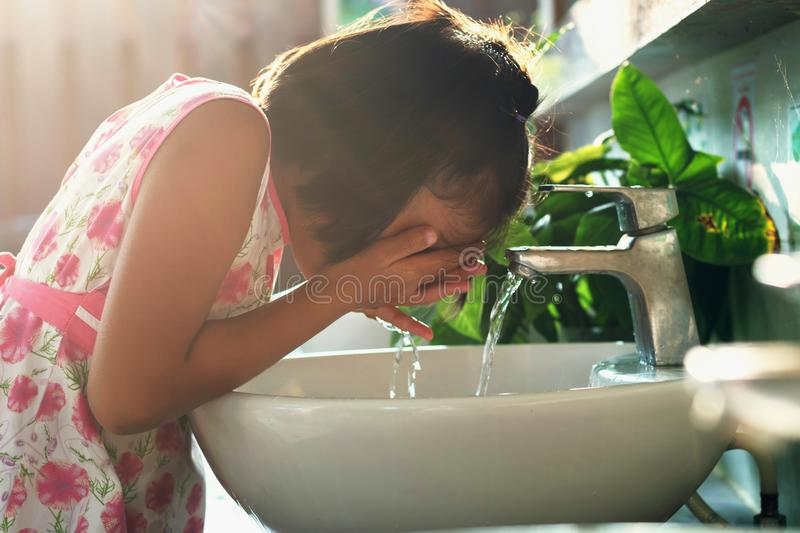Children washing face. In basin royalty free stock image