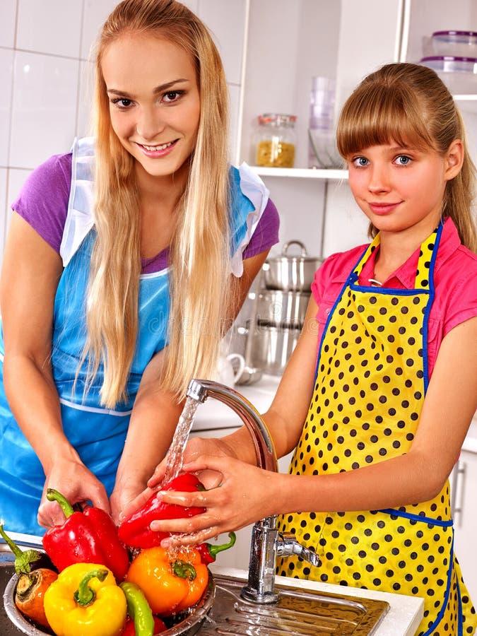 Children washing fruit at kitchen. royalty free stock photos