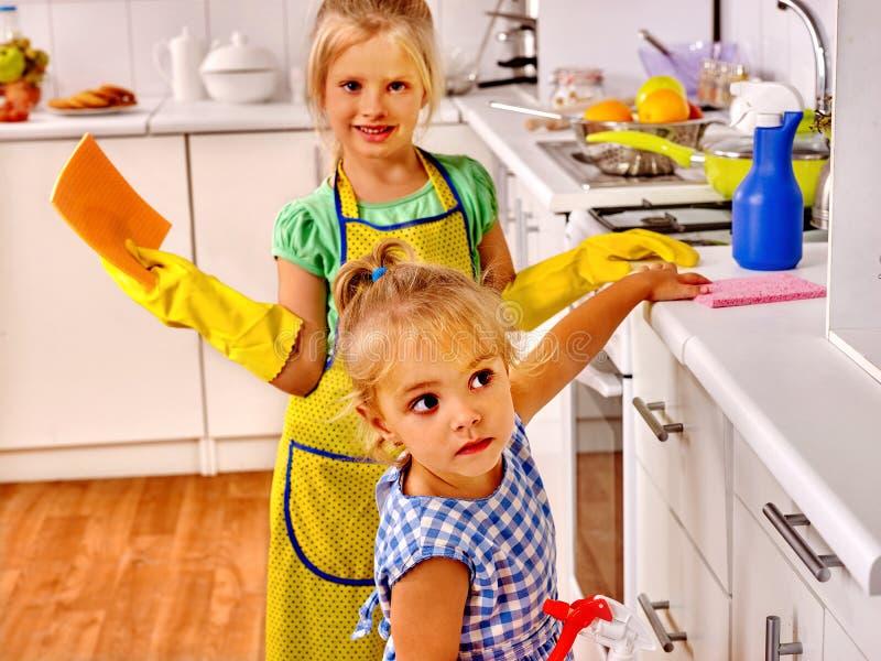 Children washing at kitchen royalty free stock images
