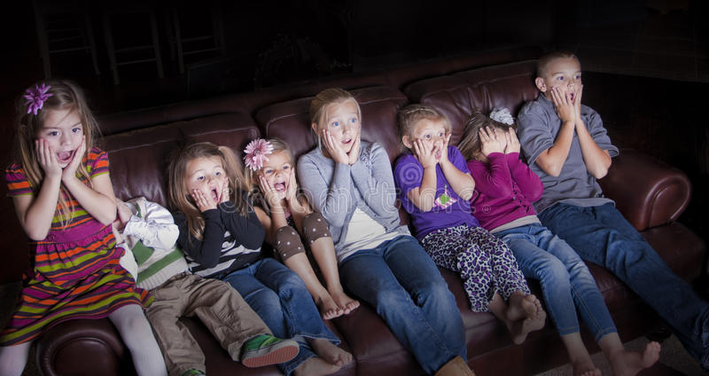 Children watching Shocking Television Programming stock photo