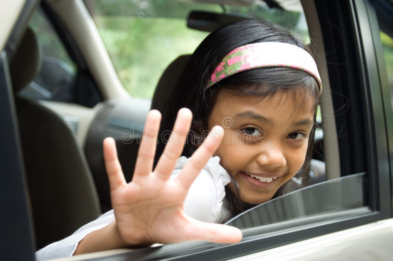 Children waving goodbye stock image