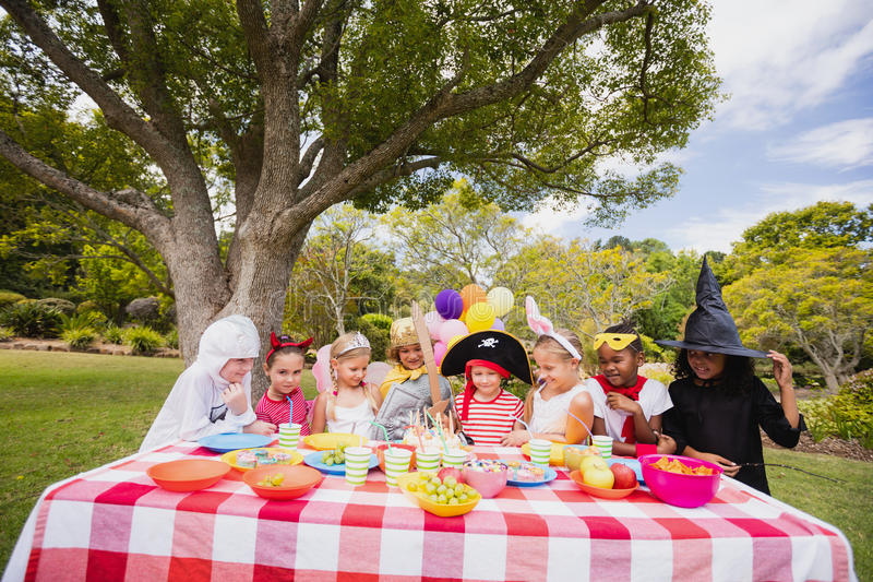 Children wearing costume having fun during birthday party stock photography