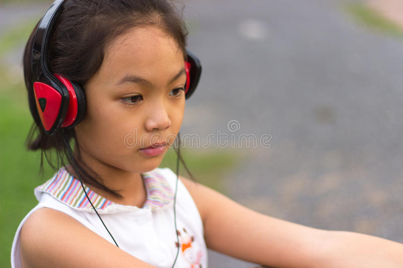 Children wearing headphones listening pleasure. Children wearing red headphones listening pleasure stock photos