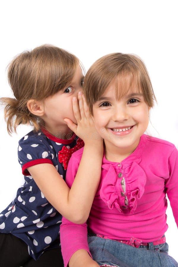 Children whispering royalty free stock image