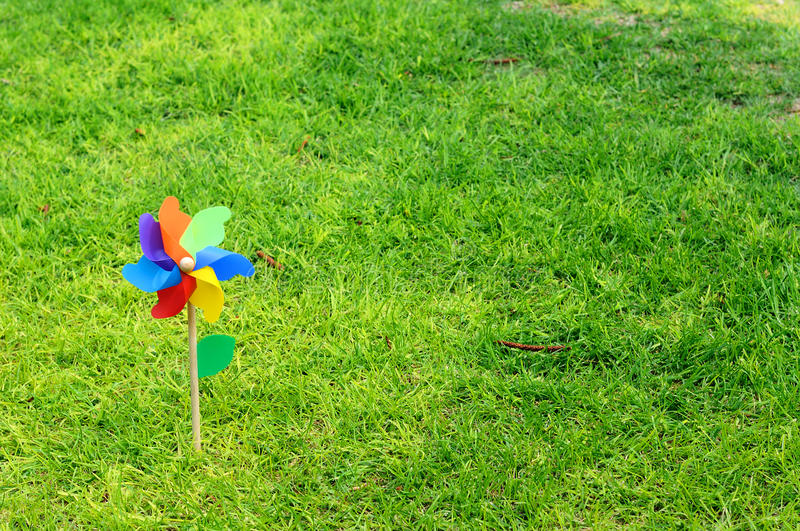 Children windmill. On a sunny green lawn royalty free stock images