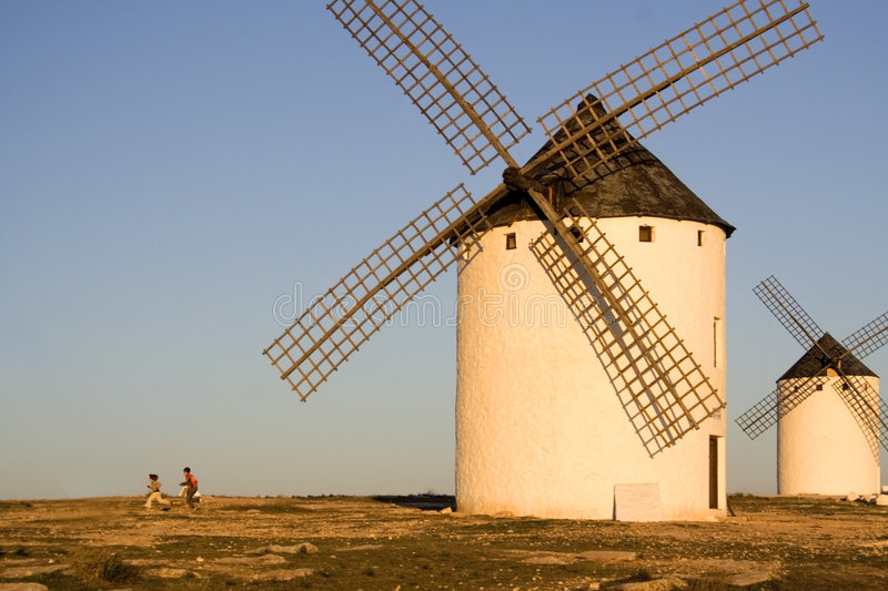 Children and windmills stock image