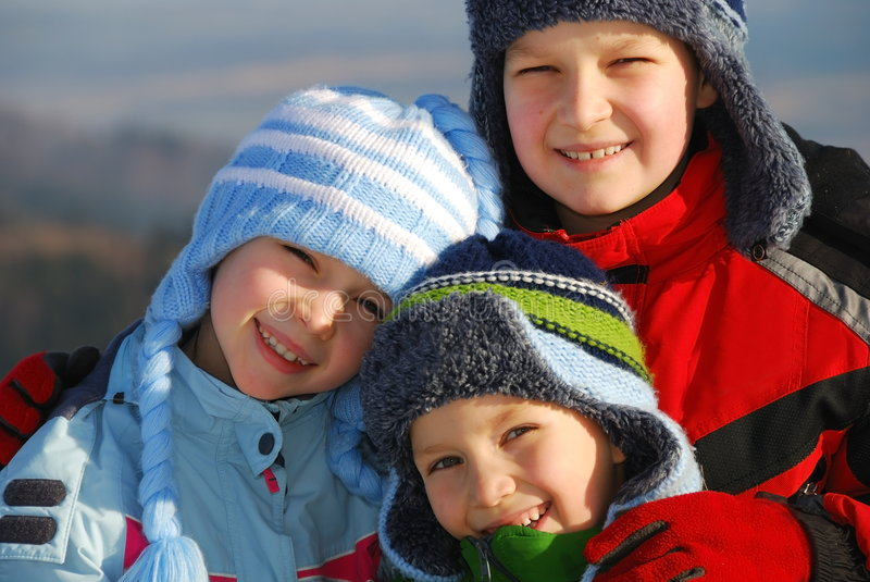 Children in winter clothes stock image