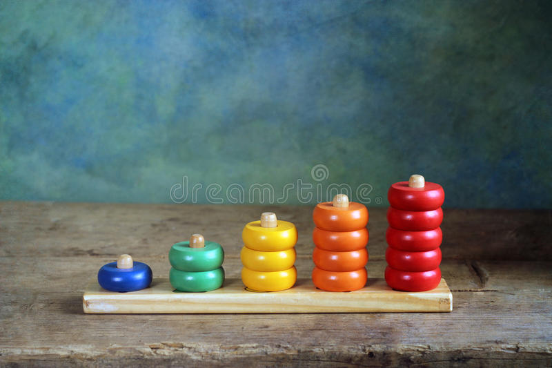 Children wooden colorful figures royalty free stock photography