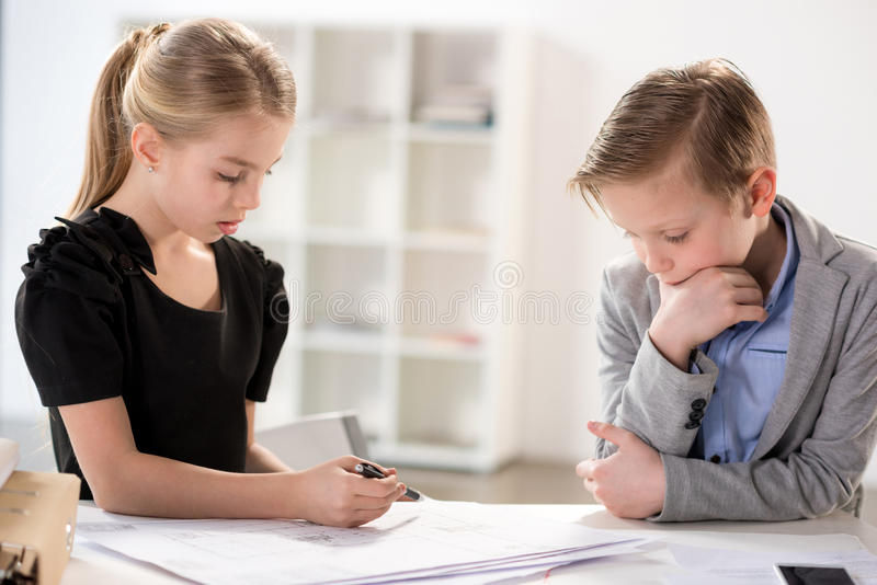Children working in office. Like adult business people stock photos