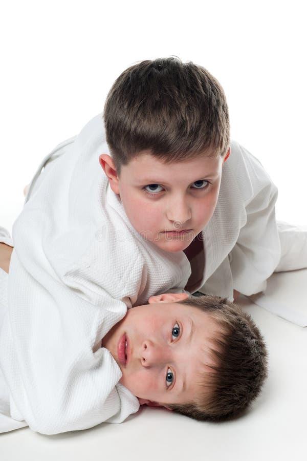 Download Children wrestling stock image. Image of costume, judo - 24429051