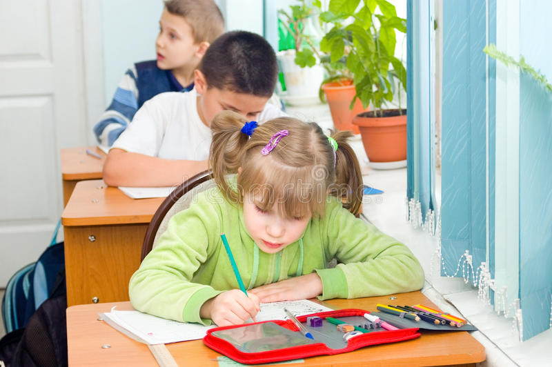 Download Children write at a lesson stock photo. Image of carry - 14164374