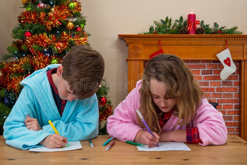 Children writing letters to Santa stock images