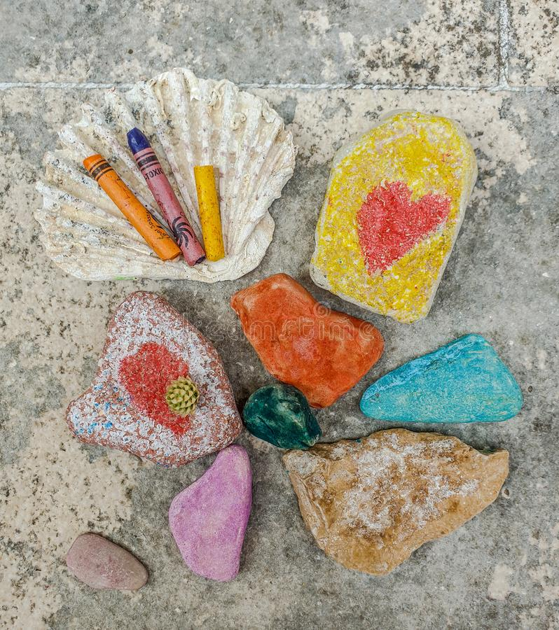 Free Children& X27;s Favorite Pastime At Sea, Painting And Drawings On Sea Stones With Crayons, Pastels, Watercolors Stock Image - 155913391