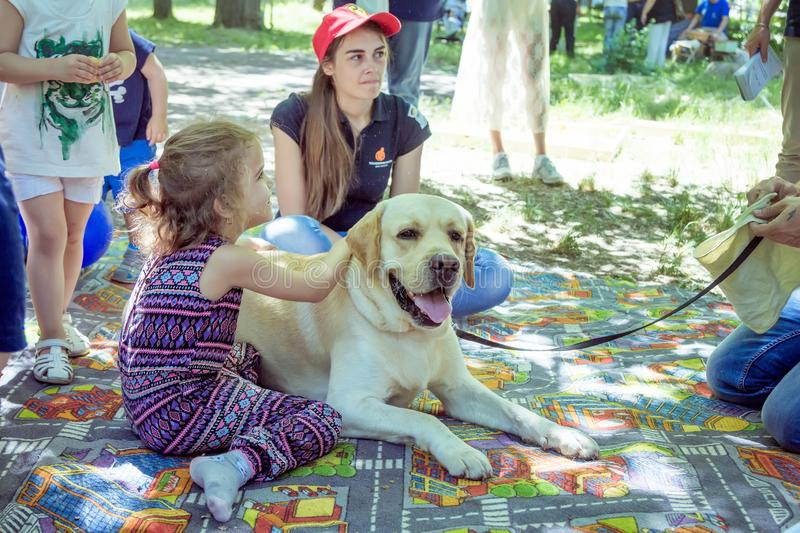 Childrenand their parents participating at dog therapy session. Zaporizhia/Ukraine- June 2, 2018: childrenand their parents participating at dog therapy session stock photos