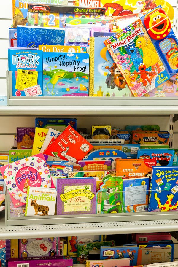 Childrens Books. Store shelf packed with popular childrens books. Titles include Dr. Suess Green Eggs and Ham, Barbie, Sesame Street, Mickey Mouse, and many stock photo