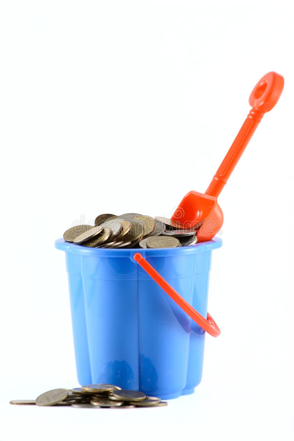 Free Childrens Bucket With Coins A Scoop Stock Photography - 13641882