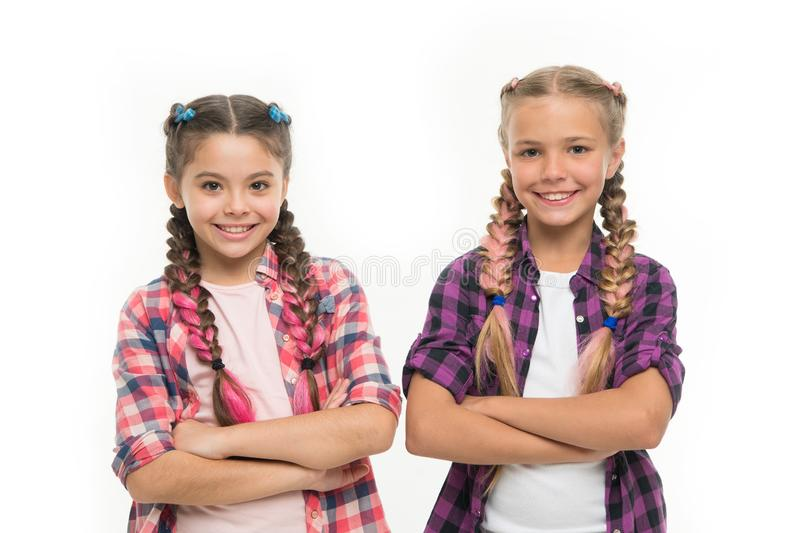 Childrens day. Back to school. Childhood happiness. Friendship and sisterhood. small girl children with perfect hair. Small kid fashion. Happy little sisters stock photo