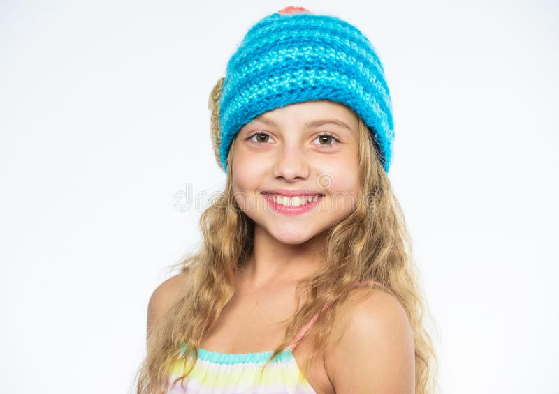 Childrens knitted hats. Girl long hair happy face white background. Kid wear warm soft knitted blue hat. Difference. Between knitting and crochet. Free knitting stock images