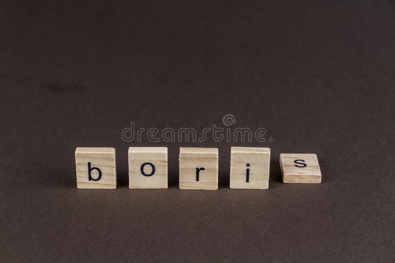 Childrens letter blocks spelling Boris with S fallen. Boris in children letter blocks, S tipped over, suggesting downfall of Boris royalty free stock images