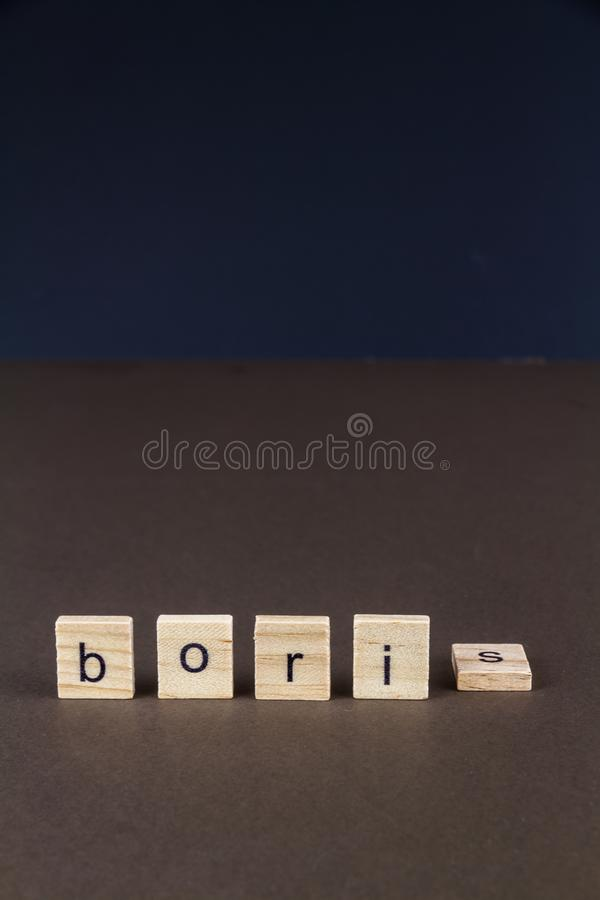 Childrens letter blocks spelling Boris with S fallen, portrait. Boris in children letter blocks, S tipped over, suggesting downfall of Boris, portrait royalty free stock photo