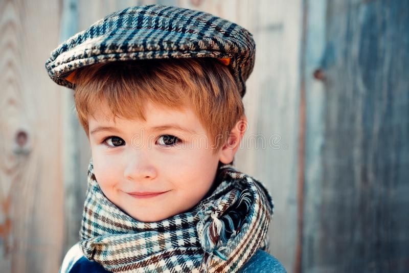 Childrens look. Beautiful face. The boy in the cap looks at the camera. Clothes for child. Childrens fashion. stock image