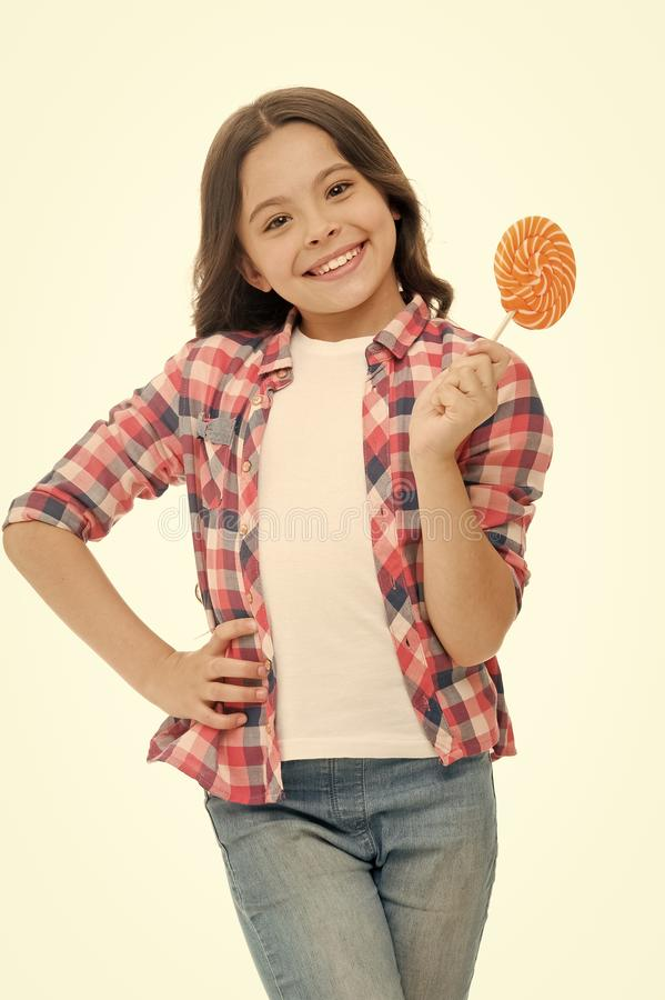 Childrens menu. Girl cute smiling face holds sweet lollipop. Sweets in appropriate portions ok. Girl likes sweets as. Lollipop candy, isolated white background royalty free stock photography
