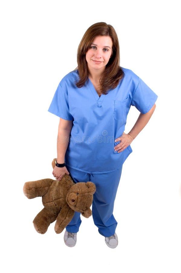 Childrens Nurse 2. Attractive Childrens Nurse Holding A Teddy Bear stock photo