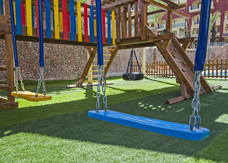 Childrens outdoor play area with swings stock photo
