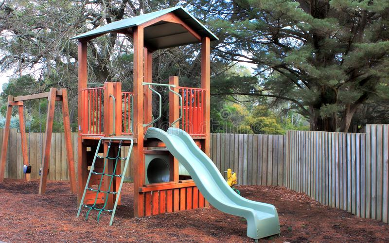 Childrens play ground. With swing, slide and climbing frame stock photography