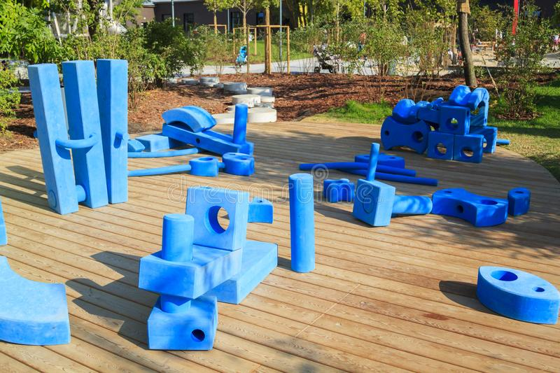 Childrens playground in park with blue giant geometric figures for the development of imagination and spatial thinking. Brick, construction, creative stock photography