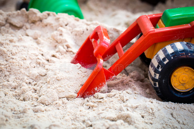 Childrens toy car in sandbox royalty free stock images
