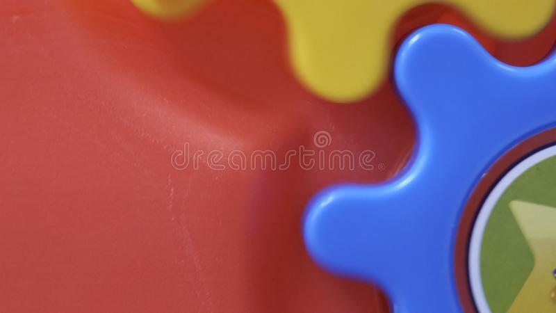 Childrens toy colored spinning gears close up. Childrens toy colored spinning gears close up royalty free stock image