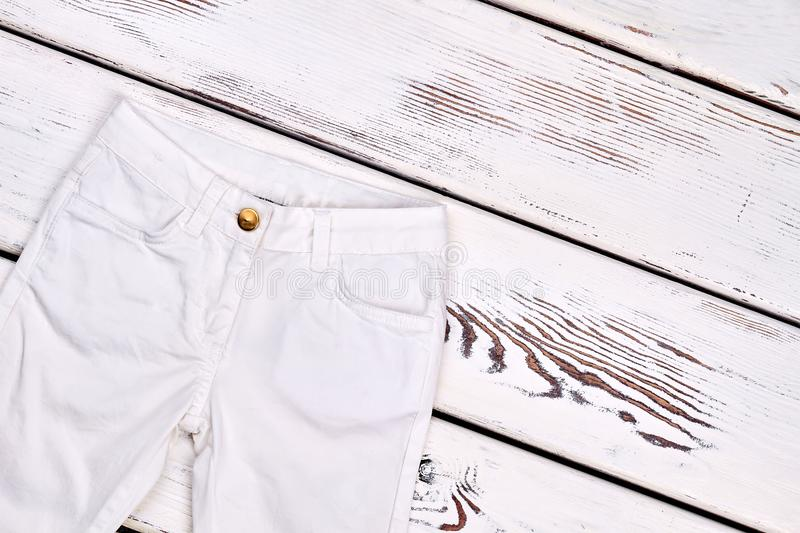 Childrens white denim trousers . royalty free stock photo