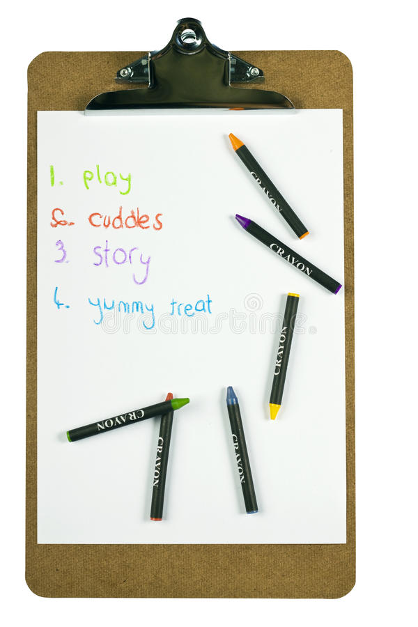 childs剪贴板蜡笔列出 免版税图库摄影