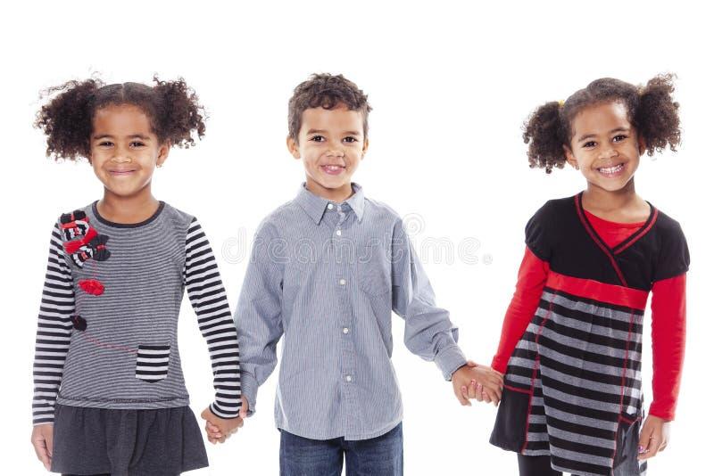 Childs afro-americanos bonitos irmão e irmã no fundo branco fotografia de stock