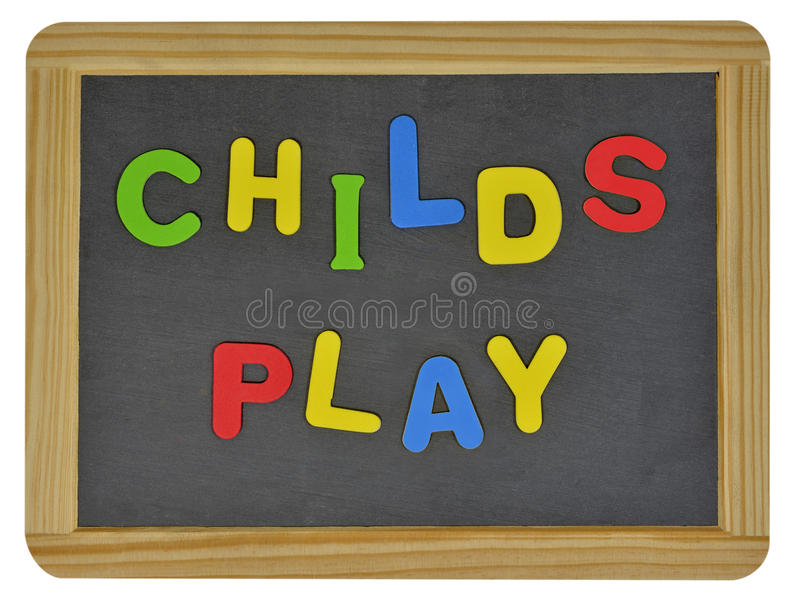 Childs play in colored letters on slate. Childs play written in colored letters on traditional slate royalty free stock photography