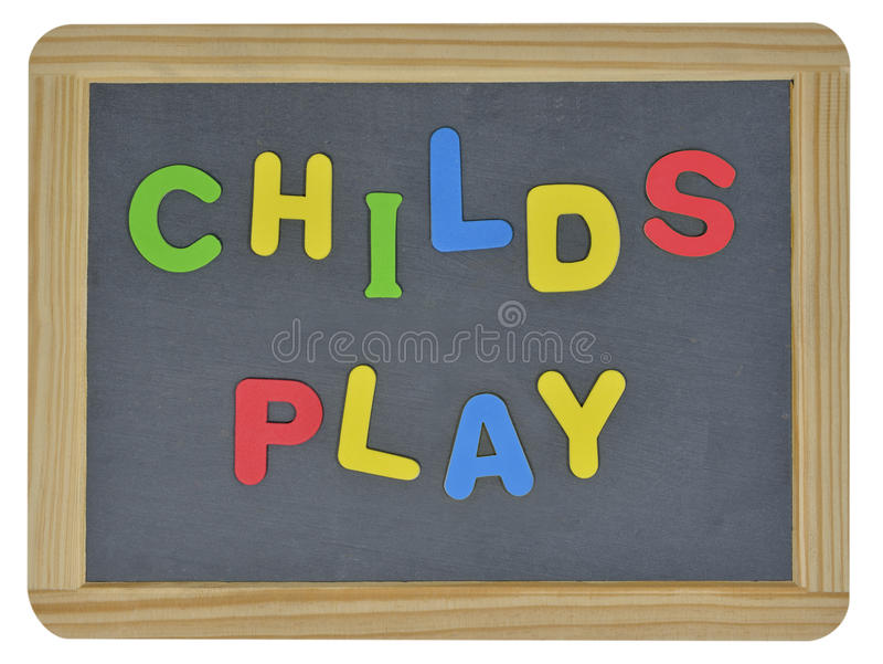 Childs play in colored letters. Childs play written in colored letters on traditional slate stock photography