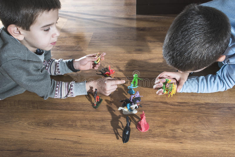 Childs playing with small toys. Childs playing with small vintage toys on the floor royalty free stock image