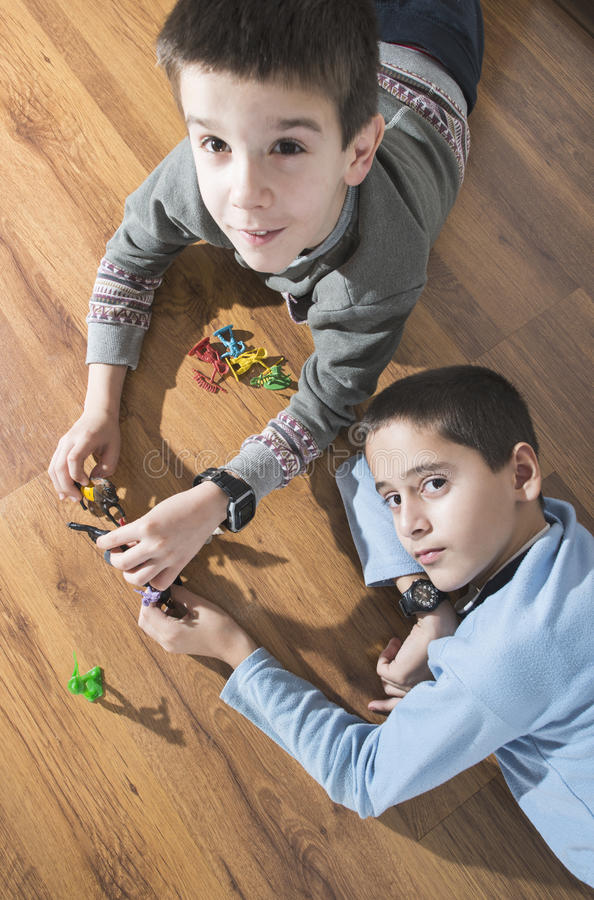 Childs playing with small toys. Childs playing with small vintage toys on the floor stock photography