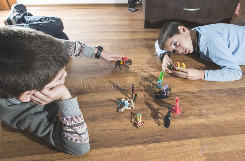 Childs playing with small toys. Childs playing with small vintage toys on the floor royalty free stock photography