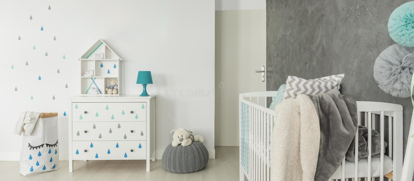 Childs room with white cot. Comfortable childs room in scandi style with white cot royalty free stock images