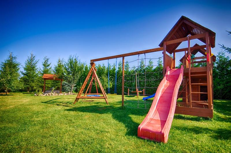 Childs slide and swings royalty free stock image
