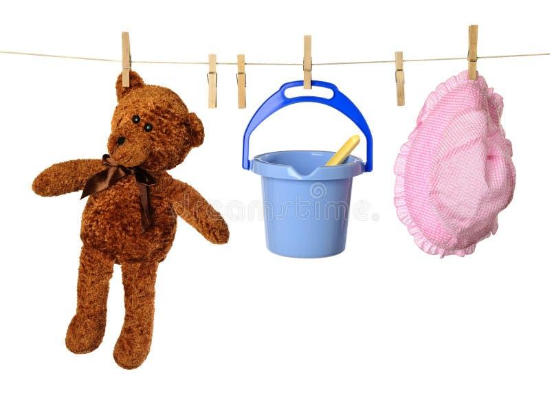 Childs waschende Zeile stockfotografie