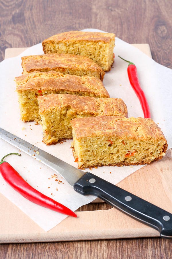 Chile cheese cornbread. And hot red pepper stock image