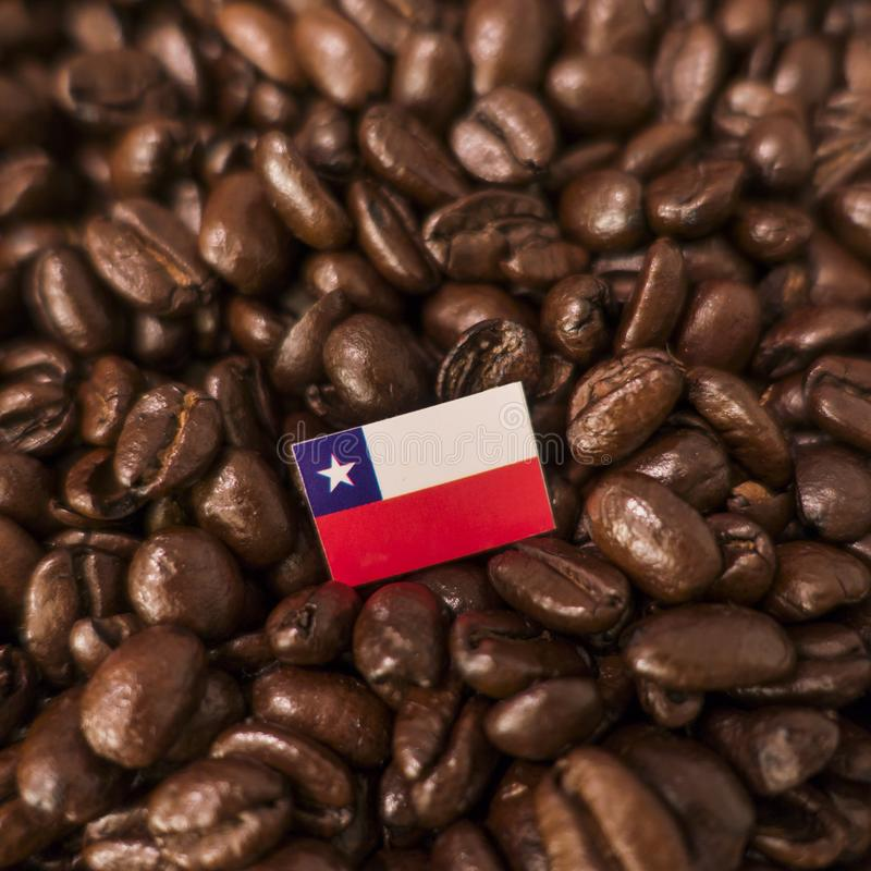 A Chile flag placed over roasted coffee beans royalty free stock photos