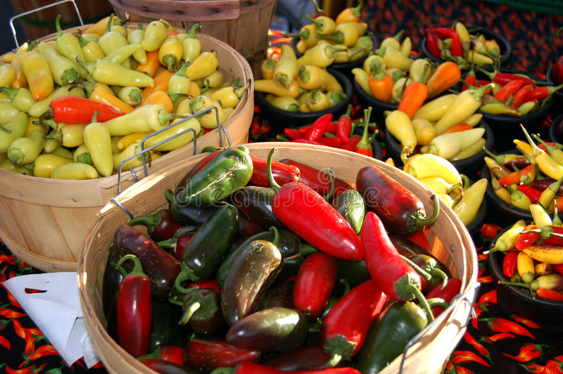 Chile Harvest. Bushels of chiles on display at a farmer's market stock photos