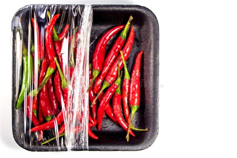 Chile rojo en paquete de la espuma y del plástico fotografía de archivo libre de regalías