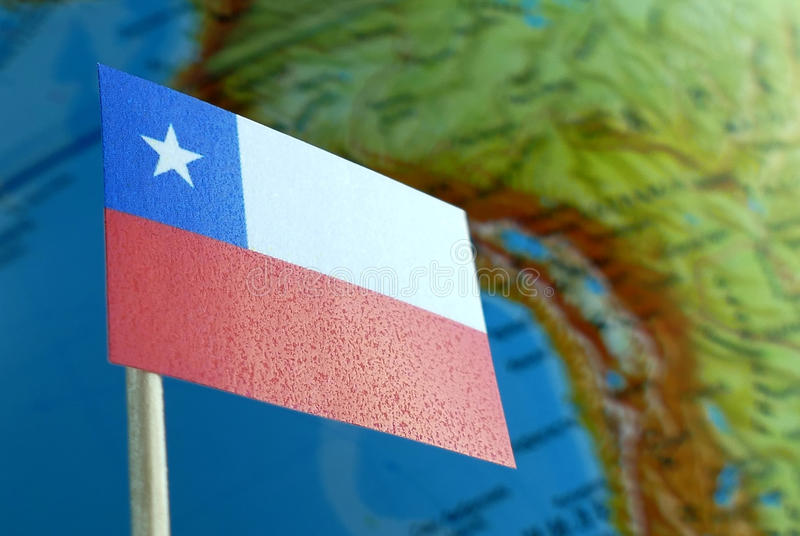 Chilean flag with a globe map as a background royalty free stock photo